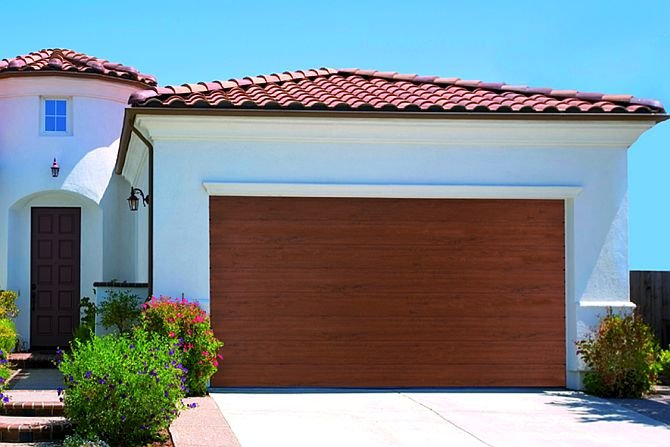 Na jakie czynniki należy zwrócić uwagę przed wyborem bramy garażowej?