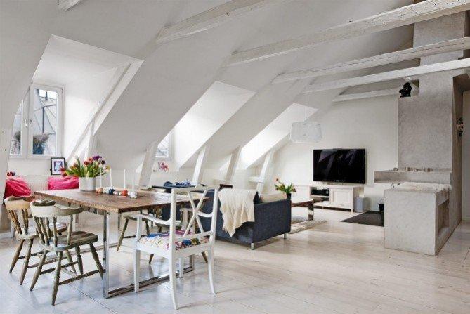 Apartament na poddaszu z kominkiem i belkami sufitowymi
