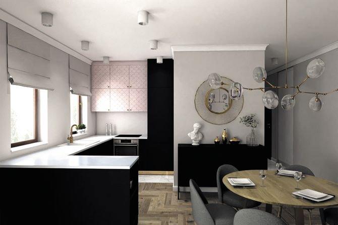 Obszerna kuchnia z zabudową w kształcie litery U oraz ukryta za ścianą spiżarniaFot. Pracownia Architektoniczna MGN