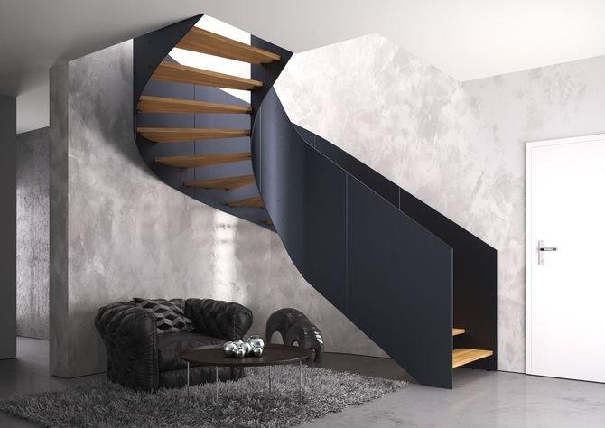 Schody spiralne Futura oparte na konstrukcji policzkowej o grubości 8 mm. Zespolona z  konstrukcją balustrada Laser pełny, malowana proszkowo na kolor czarny. Stopnie o grubości 4 cm z litego dębu w kolorze natura.
