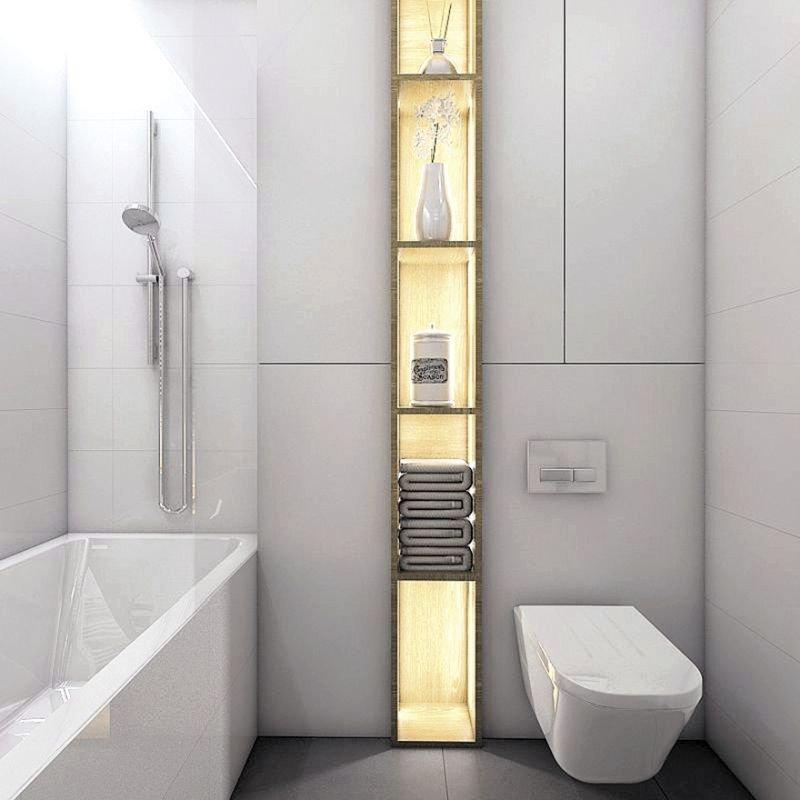 Zabudowana wnęka za sedesem jest niewidoczna, bo zlewa się z tłem ścian. W oczy rzuca się natomiast słupek z podświetlanymi półkami, prawdziwa ozdoba tej łazienki.