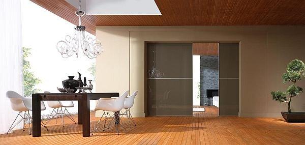 Drzwi przesuwne są alternatywą do tradycyjnych drzwi otwieranych i mogą funkcjonować jako ściana oddzielająca pomieszczenia.