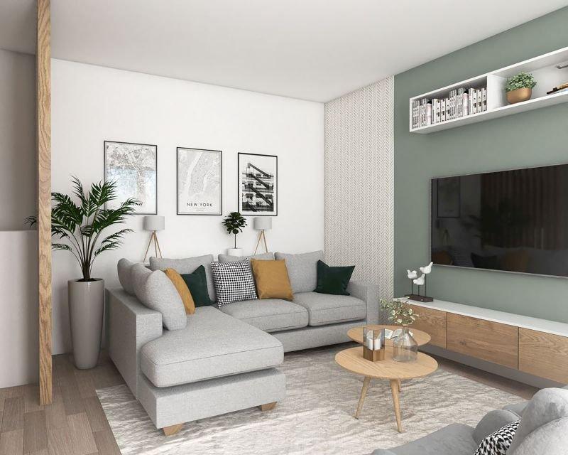 Na narożnej sofie może wygodnie odpoczywać nawet kilka osób. Umeblowanie kącika wypoczynkowego uzupełnia fotel oraz dwa lekkie stoliki. Szafka RTV została podwieszona do ściany, dzięki czemu wygląda na mniejszą i lżejszą. Jedną część długiej ściany .