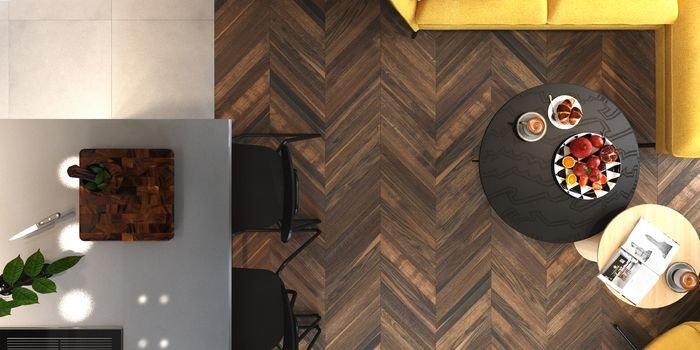 """Mieszkanie urządzone w minimalistycznej estetyce, wzbogaconej akcentami w klimacie loft oraz retro. Wyraziste połączenie wielu faktur i kolorów sprawia, że wnętrze jest dynamiczne. Projekt: Daniel Niewiadomski """"Trzy stawy"""", podłoga FertigParkiet Chevron Dąb Antykot, fot. Jawor-Parkiet"""
